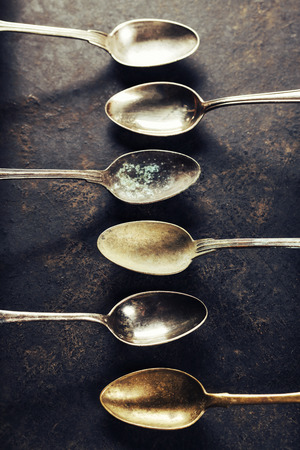 greasy: Empty pan with old spoons top view
