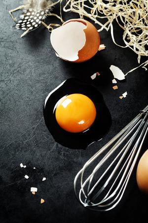 jhy: Raw egg on dark background Stock Photo