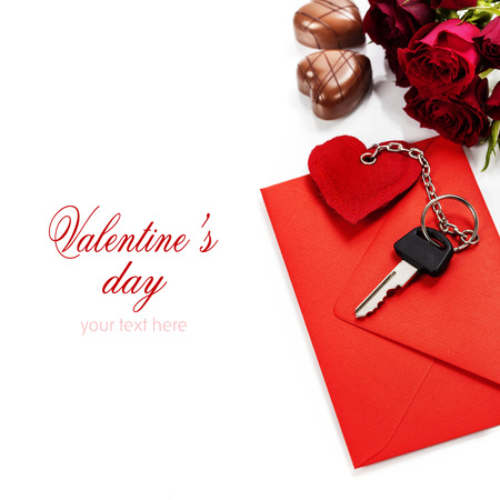 Red  envelop, roses, chocolate and key On white background photo