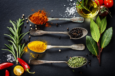 thyme: Herbs and spices selection - herbs and spices, old metal spoons and slate background Stock Photo