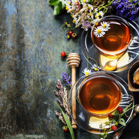wild mint: Herbal tea with honey, wild berry and flowers on wooden background