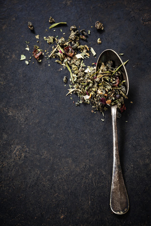 india food: Tea composition with old spoon on dark background Stock Photo