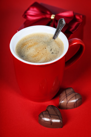 bridal couple: Valentines day composition with coffee cup and chocolate on red background
