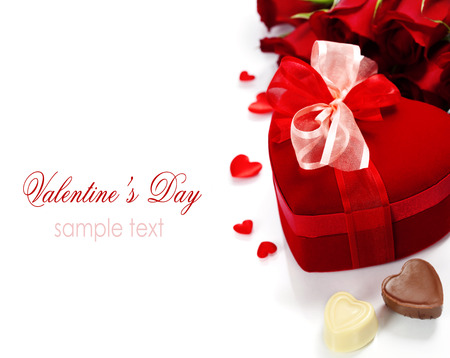 Valentine composition with roses and gift box over white (with easy removable sample text) photo