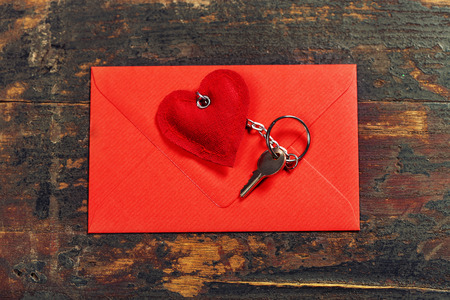 envelop: Red  envelop and key On old wood background Stock Photo