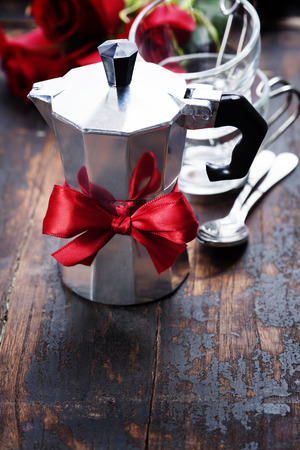 holiday maker: Valentine composition with coffee maker and flowers on wooden background Stock Photo
