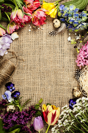 festal: Easter background with eggs, nest and flowers Stock Photo