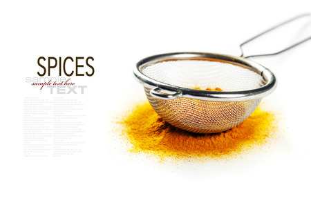 curry powder: Yellow curry powder in strainer (with easy removable sample text)