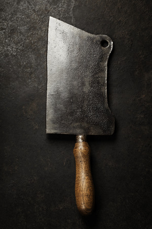 cooking implement: Meat cleaver knife on dark vintage background