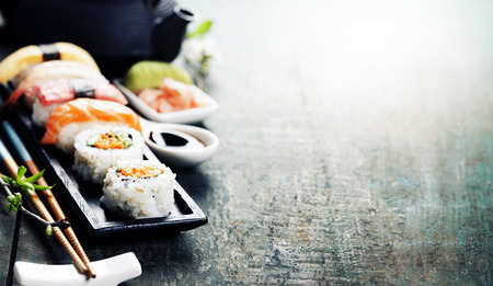 maki sushi: Closeup of fresh sushi  on rustic wooden table