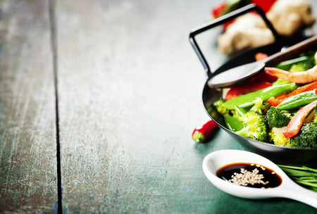 Chinese cuisine. Colorful stir fry in a wok. Shrimps with vegetables Stok Fotoğraf