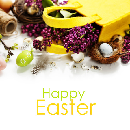Easter background with eggs, nest and flowers photo