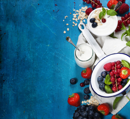 food dish: Healthy breakfast - yogurt with muesli and berries - health and diet concept