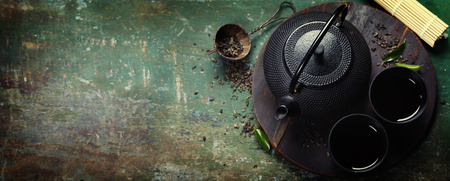 herb tea: Black iron asian tea set,vintage style Stock Photo