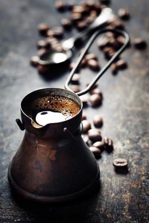 Old coffee pot on dark rustic  background Stok Fotoğraf