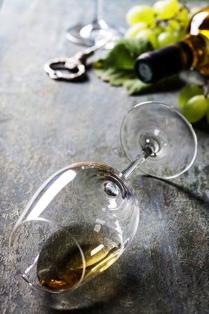 des vins: Glass of white wine on dark background Stock Photo