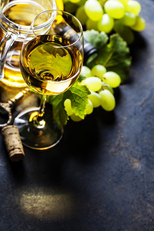 des vins: Glass of white wine on dark background Stock Photo