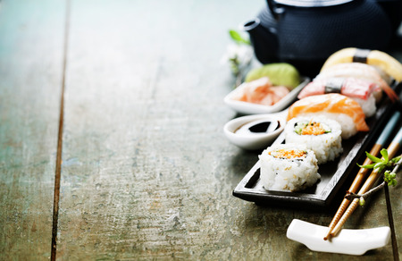 fresh vegetable: Closeup of fresh sushi  on rustic wooden table