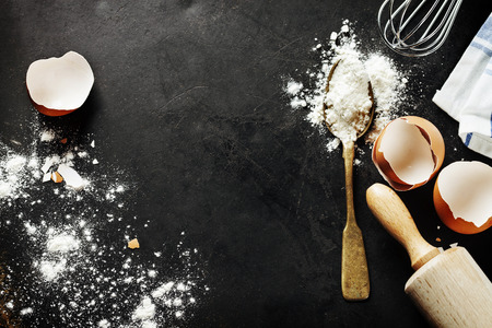 dough: baking background with eggshell and rolling pin Stock Photo