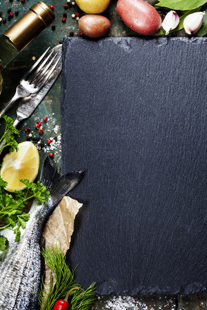black stone: Food background with Fish and Wine. Lots of copy space