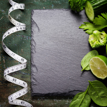 summer diet: Fresh green vegetables on vintage background - detox, diet or healthy food concept