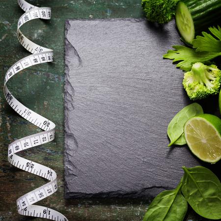 light diet: Fresh green vegetables on vintage background - detox, diet or healthy food concept
