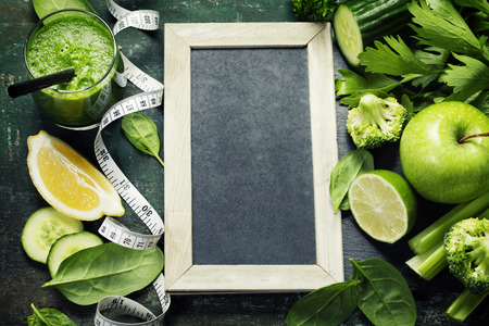 to the diet: Fresh green vegetables and smoothie on vintage background - detox, diet or healthy food concept