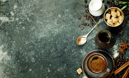 Top view of Espresso coffee, milk and sugar on black marble table. Background with space for text. Stock Photo