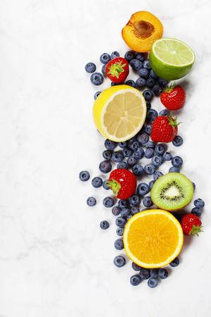 Fruits on Marble Background. Summer or Spring Organic Fruits. Agriculture, Gardening, Harvest Concept Stok Fotoğraf