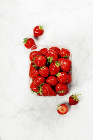 freshly picked: Transparent plastic tray with freshly picked strawberries