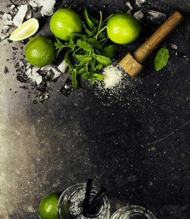 cocktail mixer: Ingredients for making mojitos (ice cubes, mint leaves, sugar and lime on rustic background)