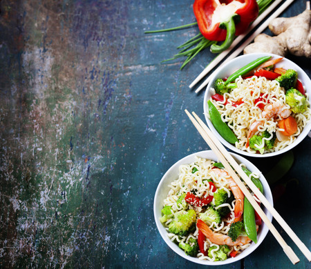 chinese noodles: Chinese noodles with vegetables and shrimps. Food background Stock Photo
