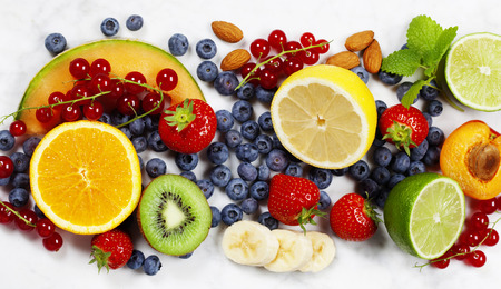 Fruits on Marble Background. Summer or Spring Organic Fruits. Agriculture, Gardening, Harvest Concept Imagens
