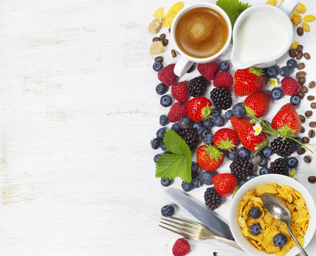 ripe: Healthy Breakfast with coffee, corn flakes, milk and berry on old wooden background. Health and diet concept Stock Photo