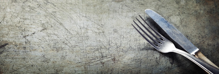table set: Dining fork and knife on rustic vintage background with copyspace Stock Photo