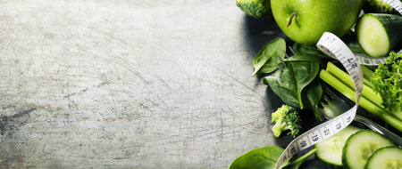 Fresh green vegetables on vintage background - detox, diet or healthy food concept Zdjęcie Seryjne - 42120374