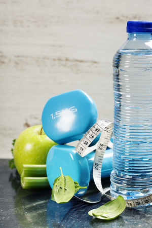 overweight body: Fresh healthy vegetables, water and measuring tape. Health, sport and diet concept Stock Photo