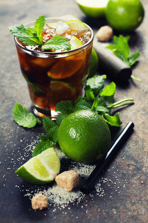 ice crushed: Ingredients for making mojitos (ice cubes, mint leaves, sugar and lime on rustic background)