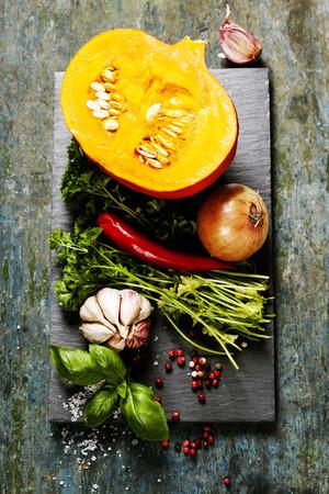 pumpkin soup: Pumpkin soup ingredients on wooden background close up Stock Photo