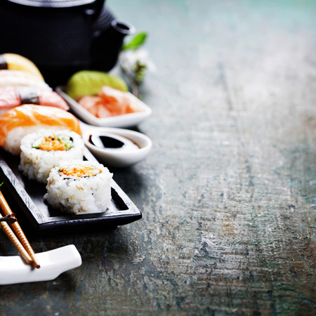 sushi: Closeup of fresh sushi  on rustic wooden table