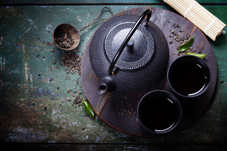 Black iron asian tea set,vintage style Фото со стока