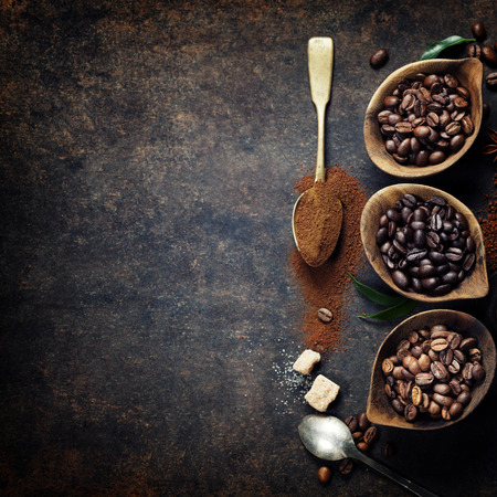 coffee table: Top view of three different varieties of coffee beans on dark vintage background