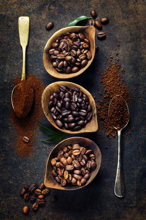 instant coffee: Top view of three different varieties of coffee beans on dark vintage background