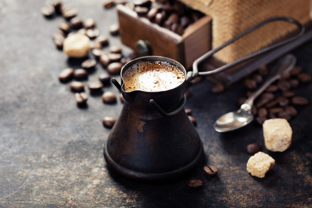 pot: Old coffee pot and mill on dark rustic  background Stock Photo