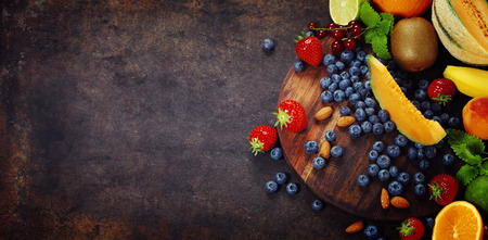 Fruits on Marble Background. Summer or Spring Organic Fruits. Agriculture, Gardening, Harvest Concept Archivio Fotografico