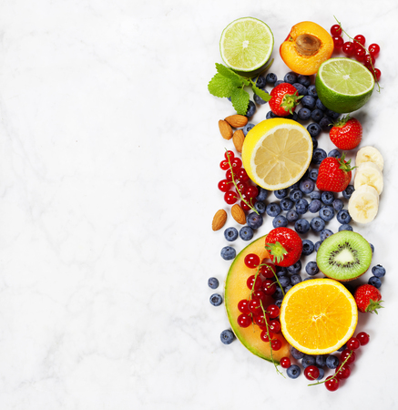 Fruits on Marble Background. Summer or Spring Organic Fruits. Agriculture, Gardening, Harvest Concept Stockfoto