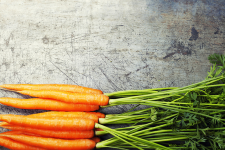 Carrots on old metal background Stock Photo