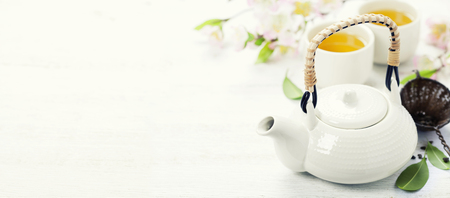Chinese Tea Set  and sakura branch on bamboo mat Imagens