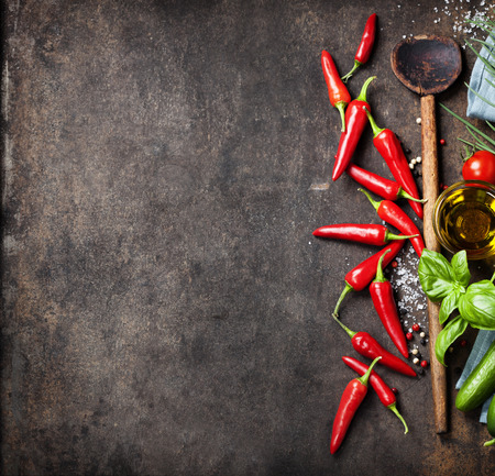 chilies: Wooden spoon and ingredients on old background. Vegetarian food, health or cooking concept.