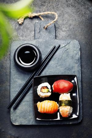 japanese cuisine: Sushi set on dark vintage background Stock Photo